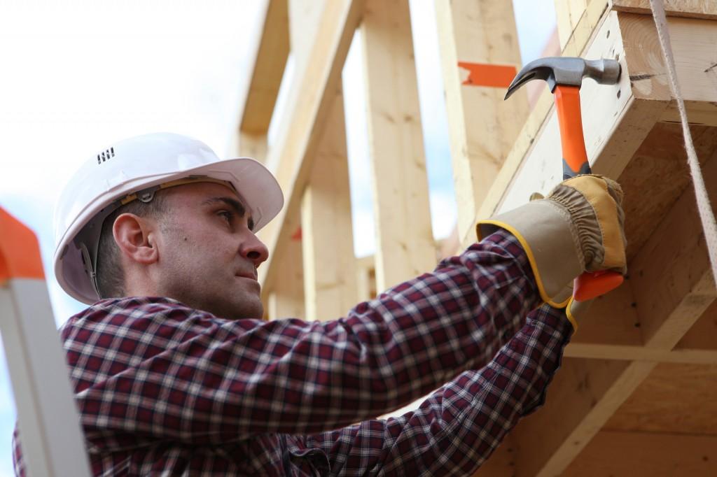 Housebuilder using a hammer
